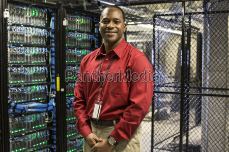 black man technician in a computer