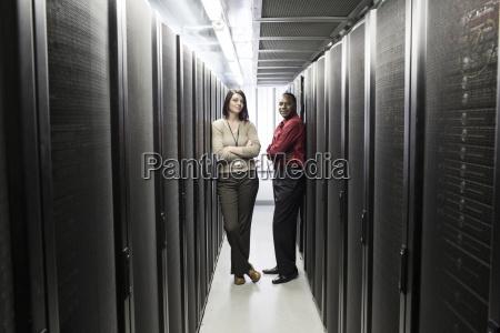 caucasian woman and black man technician
