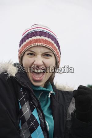 caucasian woman cheering at an informal