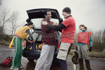 group of friends unloading gear from