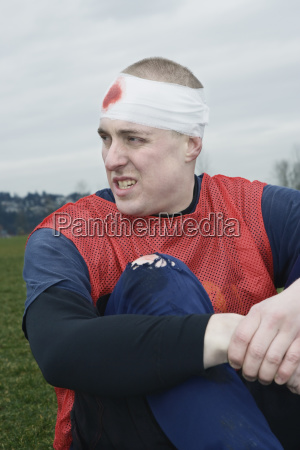 caucasian man with a bandaged head