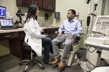 asian woman ophthalmologist working with an