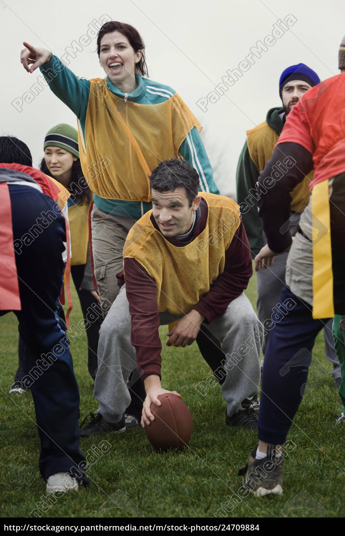 caucasian, woman, playing, quarterback, for, a - 24709884