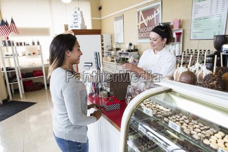caucasian woman working the cash register