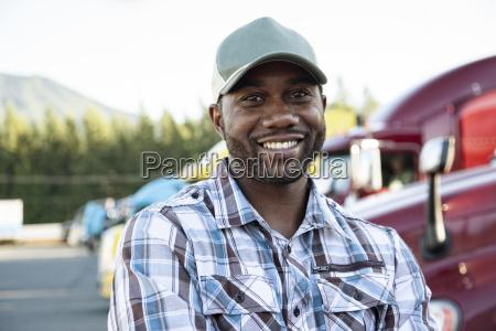black man truck driver near his