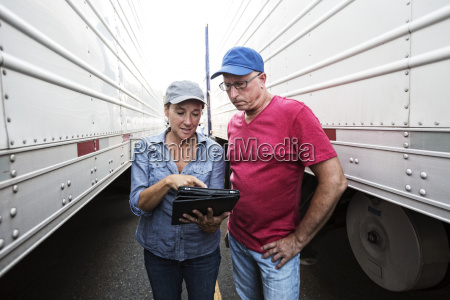 caucasian man and woman truck driving