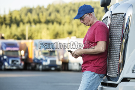 caucasian man truck driver texting while