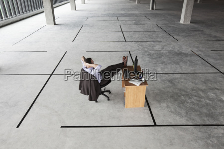 caucasian businessman at desk looking at