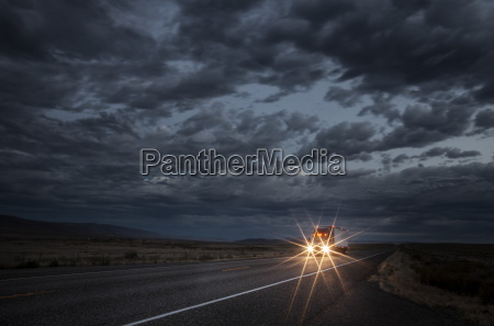 headlights of a commercial truck on