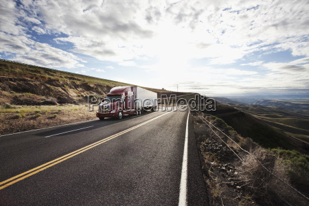 commercial truck driving through the high