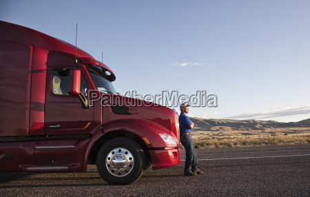 truck driver leaning on the grill