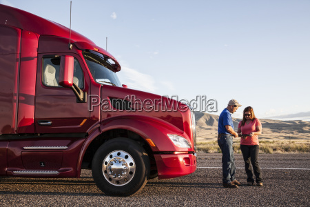 husband and wife driving team checking