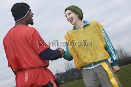 black man and caucasian woman team