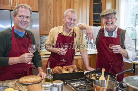 three senior men friends cooking a