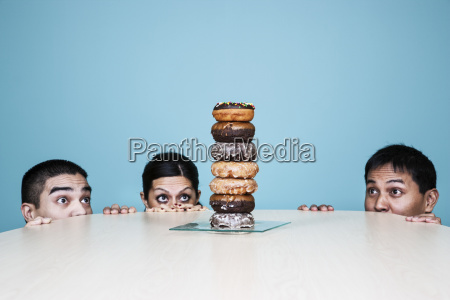business people hiding behind a table
