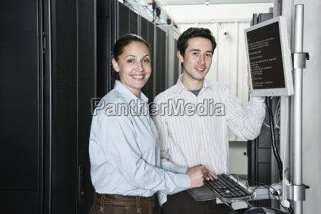 caucasian man and woman computer technicians