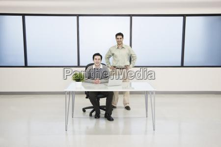 team of two caucasian businessmen in
