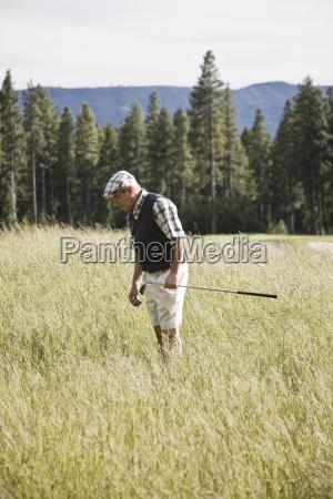 senior golfer trying to find golf