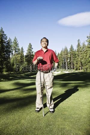a senior golfer ready to approach