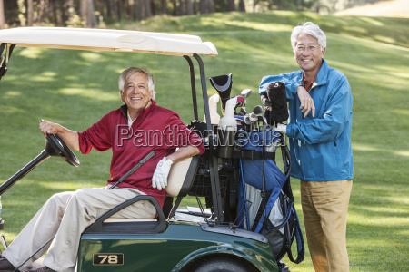 two senior male golfing buddies and