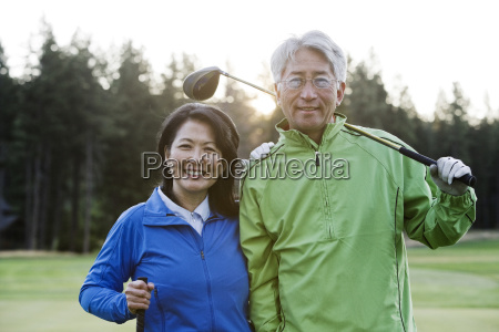 a young asian senior couple playing