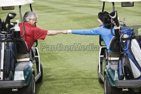 a senior couple doing a fist