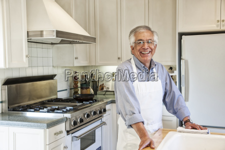 hispanic senior man in his remodelled