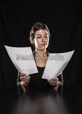 studio portraits of caucasian woman holding