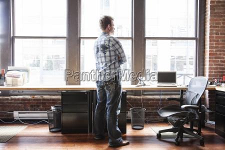 caucasian man standing near a bank
