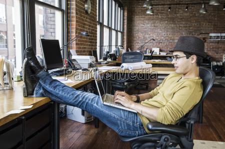 hispanic man working on his laptop