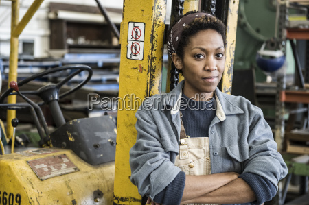 black woman factory worker and a