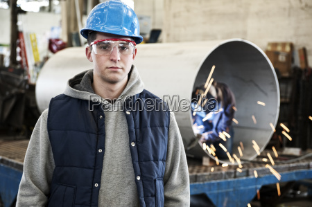 a young caucasian factory worker wearing