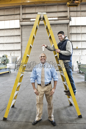 black man factory owner and young