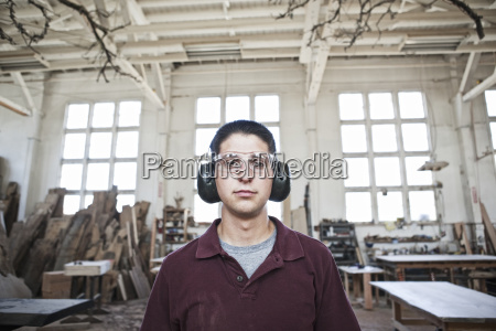 caucasian man factory worker wearing hearing