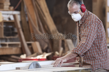 caucasian man factory worker wearing hearing