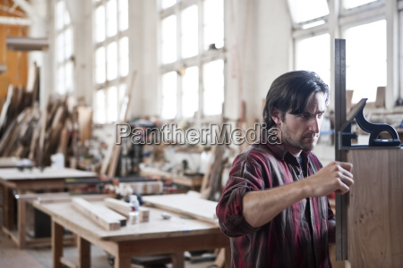caucasian man factory worker checking square