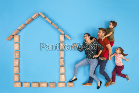 happy family with keys coming to