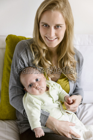smiling mother with her baby boy