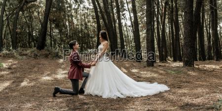 man kneeling making a marriage proposal