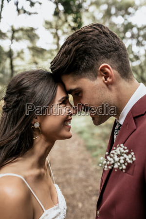 happy wedding couple head to head