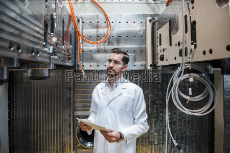 man wearing lab coat and safety