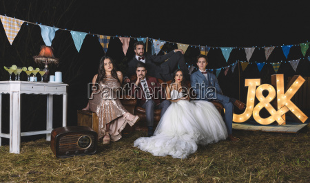 portrait of wedding couple with friends
