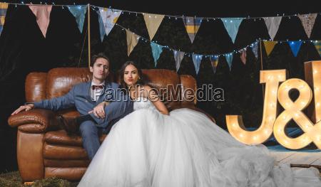 portrait of wedding couple pouting sitting