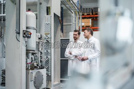 two men wearing lab coats in