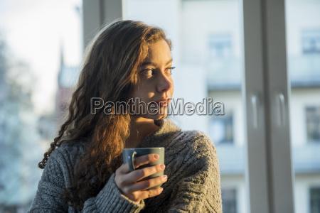 portrait of teenage girl with coffee