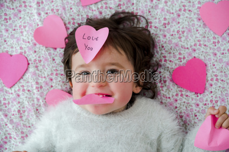 portrait of baby girl with pink