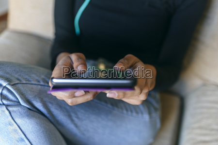 womans hands using tablet close up