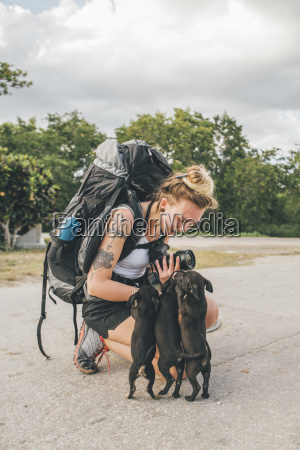 cuba young woman with backpack stroking
