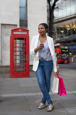 uk london smiling woman with cell