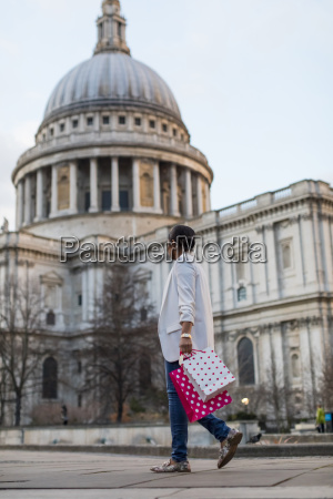 uk london woman walking with shopping